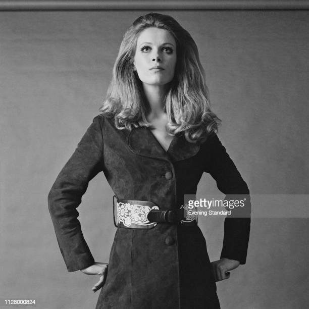 A fashion model wearing a suede coat with decorated belt UK 24th February 1969