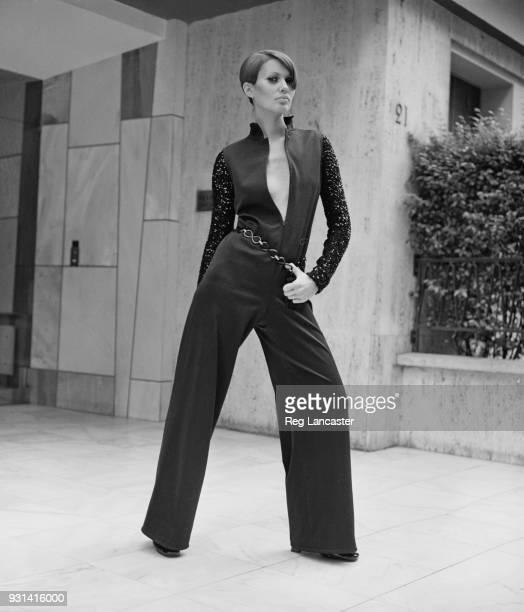 Fashion model wearing black flare trousers crepe jumpsuit by Yves Saint Laurent, Paris, France, 19th August 1968.