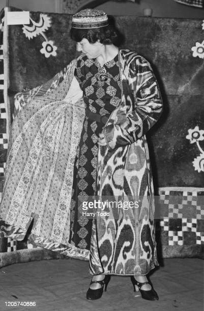 A fashion model wearing gold embroidered silk gown and cap a traditional outfit worn in Uzbekistan during occasions at the Soviet Folk Art and...