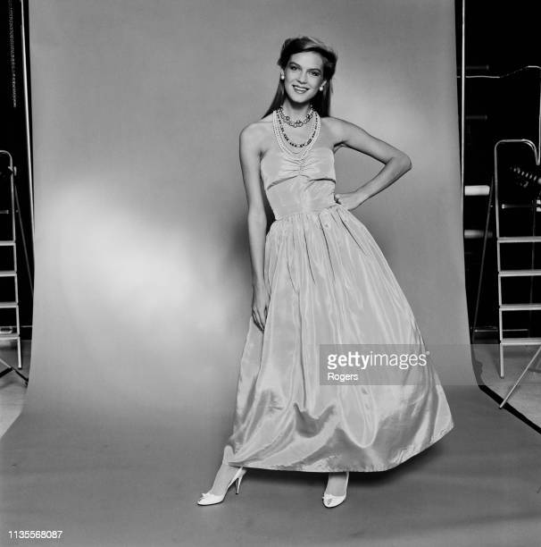 A fashion model wearing Laura Ashley evening gown UK 17th September 1983
