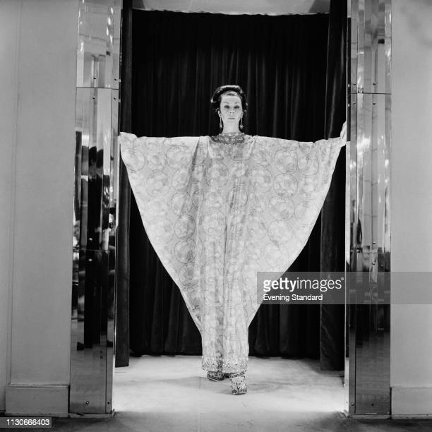 A fashion model wearing tunic dress by British fashion designer Norman Hartnell UK 21st January 1969