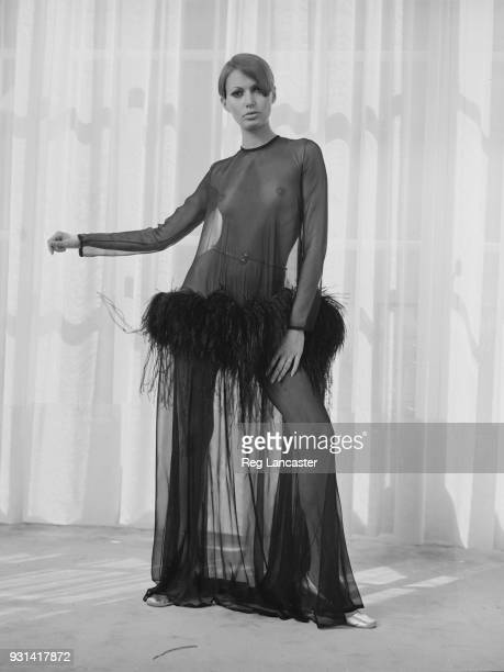 Fashion model wearing Yves Saint Laurent see though long dress, Paris, France, 19th August 1968.