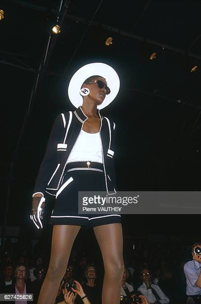 A fashion model wears a blackandwhite readytowear suit and brimmed hat by German fashion designer Karl Lagerfeld for French fashion house Chanel She...