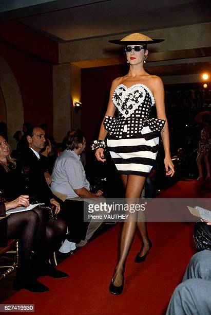 A fashion model wears a blackandwhite striped and plaid readytowear strapless skirt from French design house Christian Lacroix at the 1988...