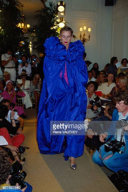 A fashion model wears a blue haute couture evening gown by French fashion designer Marc Bohan for the Christian Dior fashion house She modeled the...