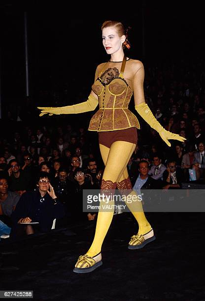 A fashion model wears a bustier with hot pants and leggings by French fashion designer JeanPaul Gaultier at his springsummer 1988 fashion show in...