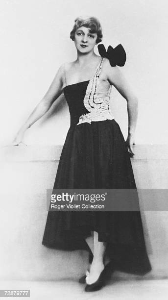 A fashion model wears a dress designed by French fashion designer Jeanne Lanvin Paris early 20th Century