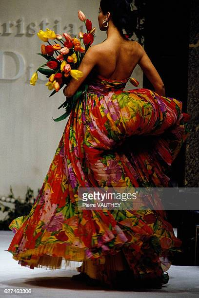 Fashion model wears a floral print haute couture evening gown by Italian fashion designer Gianfranco Ferre for French fashion house Christian Dior...