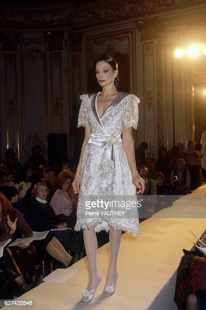 A fashion model wears a haute couture cocktail dress by French fashion designer Emanuel Ungaro She modeled the dress during his springsummer 1981...