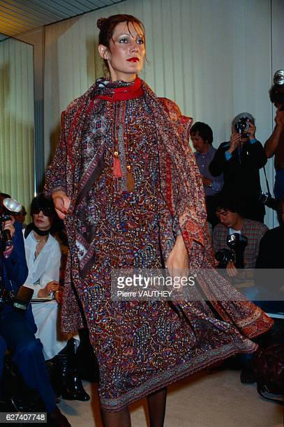 A fashion model wears a haute couture dress by French fashion designer Emanuel Ungaro She modeled the dress during his autumnwinter 19771978 fashion...