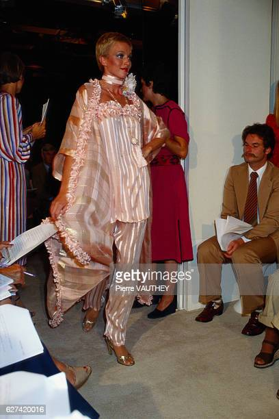 A fashion model wears a haute couture pantsuit with a matching robe by French fashion designer Emanuel Ungaro She modeled the suit during his...