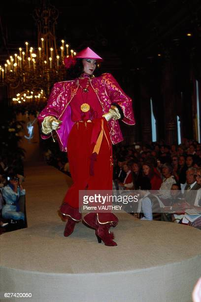 A fashion model wears a Mandarinstyle haute couture blazer and pants outfit by French fashion designer Yves Saint Laurent She modeled the outfit...