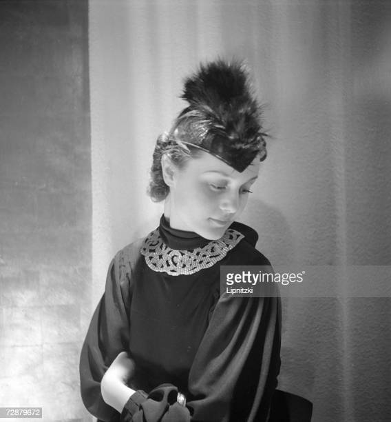 A fashion model wears a plumed hat designed by French fashion designer Jeanne Lanvin Paris January 1936