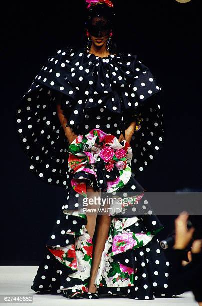 A fashion model wears a polka dot and floral print haute couture evening gown with ruffles by French fashion designer Emanuel Ungaro during his...