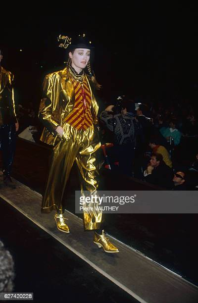 A fashion model wears a readytowear gold lame outfit by French fashion designer Jean Paul Gaultier She is modeling the outfit during his AutumnWinter...