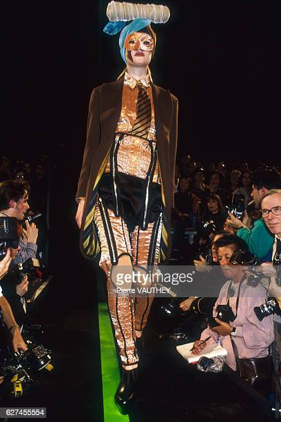 A fashion model wears a readytowear outfit and blazer by French fashion designer Jean Paul Gaultier She is modeling the outfit during his...