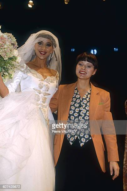 A fashion model wears a readytowear wedding dress and veil by French fashion designer Lolita Lempicka She modeled the dress during the springsummer...