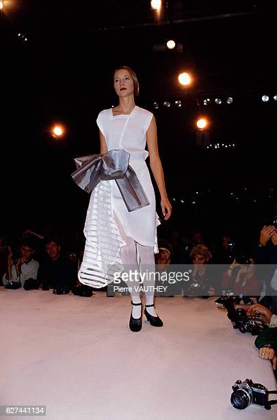 A fashion model wears a readytowear white sleeveless dress by Japanese fashion designer Rei Kawakubo for French fashion house Comme des Garcons at...