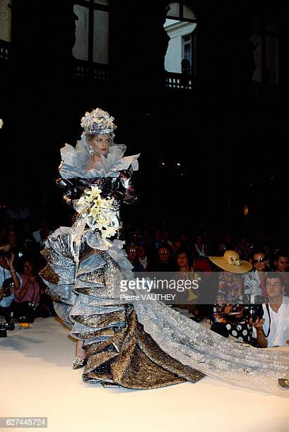 A fashion model wears a ruffled evening gown with a long lace train by French fashion designer Emanuel Ungaro at his autumnwinter 19871988 fashion...