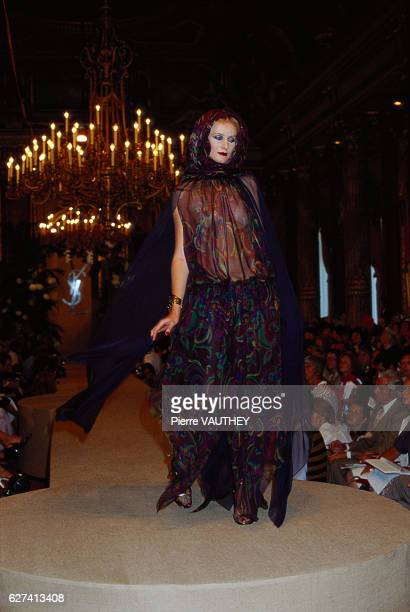 A fashion model wears a sheer black haute couture evening gown by French fashion designer Yves Saint Laurent She modeled the gown during his...