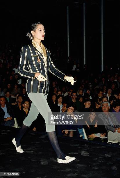 A fashion model wears a striped blazer with leggings by French fashion designer JeanPaul Gaultier at his springsummer 1988 fashion show in Paris...