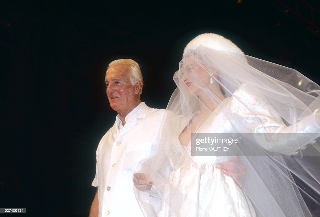 A fashion model wears a women's haute couture wedding dress and veil by French fashion designer Hubert de Givenchy (pictured) at his Autumn-Winter 1991-1992 fashion show in Paris.