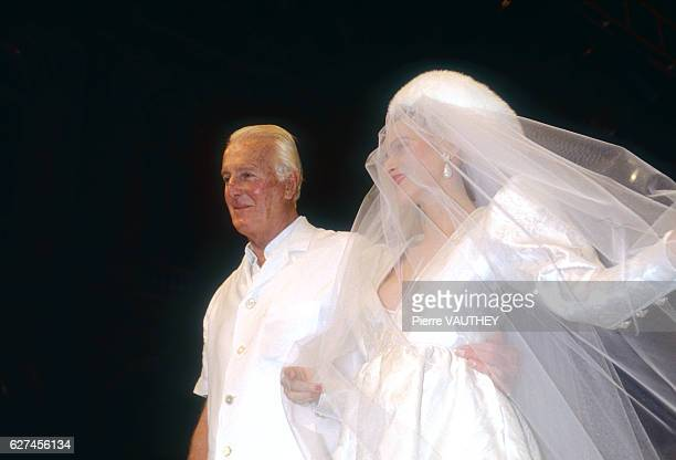 A fashion model wears a women's haute couture wedding dress and veil by French fashion designer Hubert de Givenchy at his AutumnWinter 19911992...