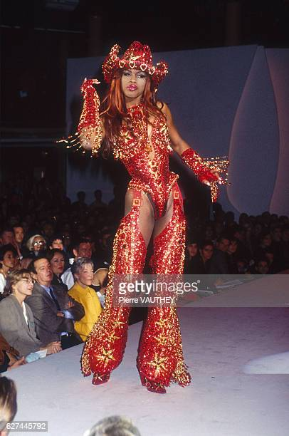 A fashion model wears a women's readytowear glittery red cowgirl outfit with chaps and a cowboy hat by German fashion designer Thierry Mugler at his...
