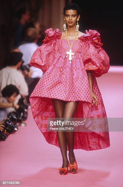 A fashion model wears a women's readytowear hot pink dress by French fashion designer Christian Lacroix at his SpringSummer 1992 fashion show in Paris