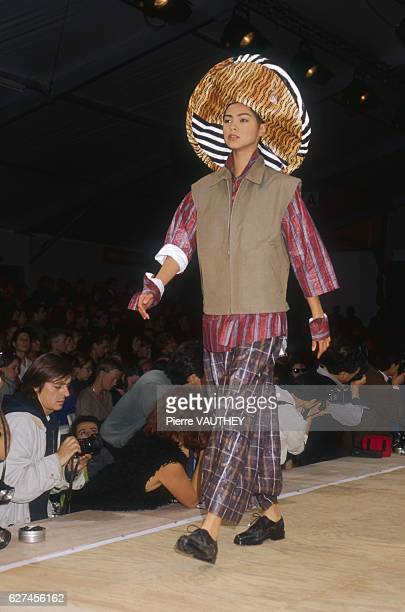 A fashion model wears a women's readytowear outfit with a widebrimmed hat by Japanese fashion designer Rei Kawakubo for the European fashion house...