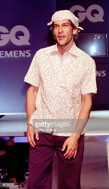 A fashion model wears an outfit from the Hackett Spring/Summer collection 2001 during the GQ fashion party May 7 2001 in Madrid Spain