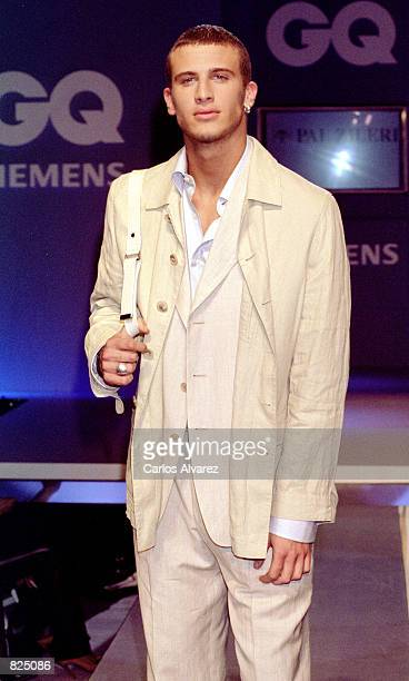 A fashion model wears an outfit from the Pal Zileri Spring/Summer collection 2001 during the GQ fashion party May 7 2001 in Madrid Spain