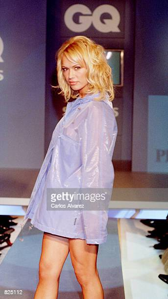 A fashion model wears an outfit from the Peter Murray Spring/Summer collection 2001 during the GQ fashion party May 7 2001 in Madrid Spain