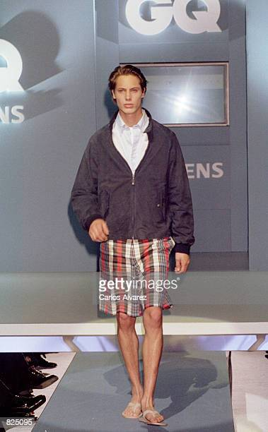 A fashion model wears an outfit from the Tommy Hilfiger Spring/Summer collection 2001 during the GQ fashion party May 7 2001 in Madrid Spain