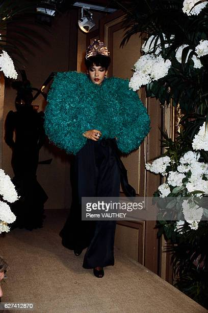 A fashion model wears haute couture women's fashions from French fashion house Yves Saint Laurent during a 19821983 fallwinter fashion show Her...
