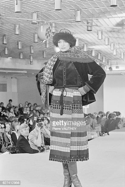 A fashion model wears readytowear women's fashions by French designer Yves Saint Laurent for his French fashion house during a 19761977 FallWinter...