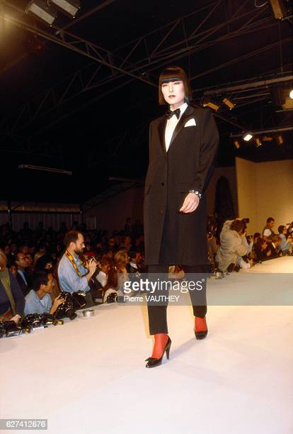 Fashion model wears ready-to-wear women's fashions by Marc Bohan for French fashion house Christian Dior during a 1982-1983 Fall-Winter fashion show...