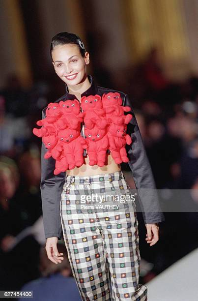 A fashion model wears readytowear women's fashions during a 1997 springsummer fashion show for French designer Jean Charles de Castelbajac Her outfit...