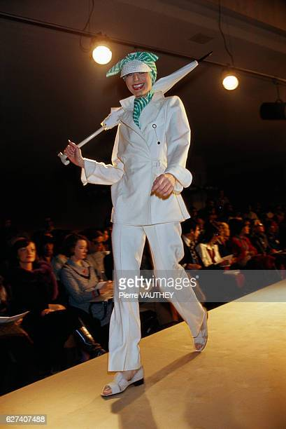 Fashion model wears ready-to-wear women's fashions from French fashion house Chloe during a 1976 Spring-Summer fashion show in Paris. She wears a...