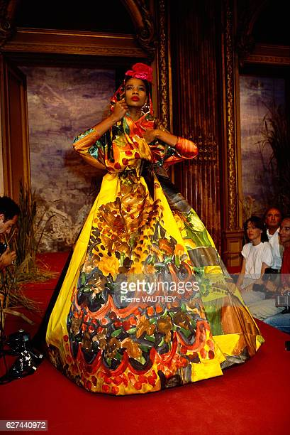 A fashion model wears the latest haute couture fashions by French designer Christian Lacroix at his 19871988 FallWinter fashion show in Paris She...