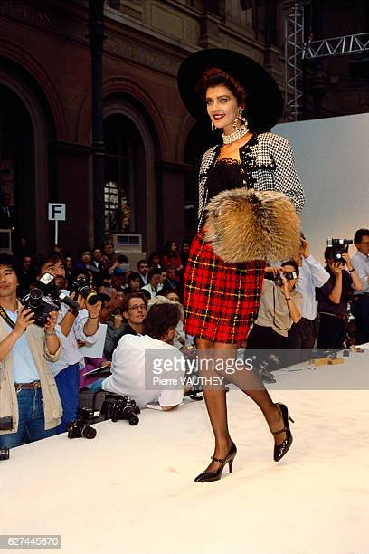 A fashion model wears the latest in haute couture women's fashions by French design house Chanel at the 19871988 FallWinter fashion show in Paris She...