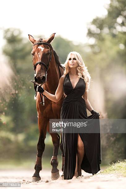 Fashion model with a horse.