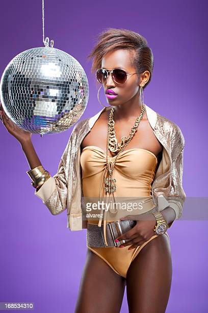 fashion model with disco ball - all hip hop models stock photos and pictures