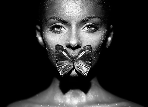 Fashion model woman with blue butterfly 1192635910