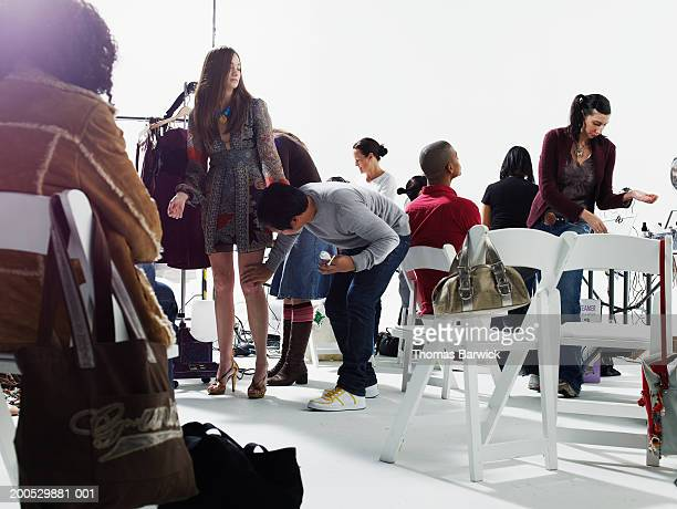 fashion models and stylists backstage at fashion show - fashion show stock pictures, royalty-free photos & images