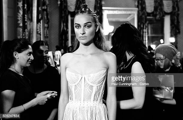 Fashion models are prepared in hair and make up backstage at the Kristian Aadnevik Spring Summer 2015 fashion show during London Fashion Week 2015...