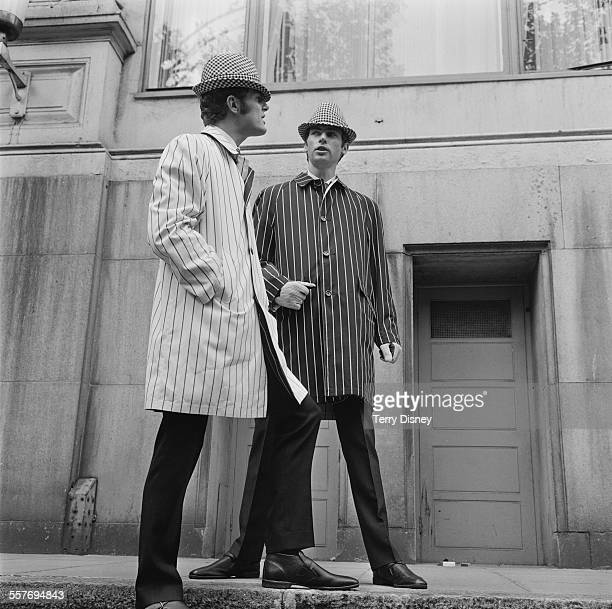 Fashion models Dennis and John Myers showing coats and hats designed by Hardy Amies for Hepworth Son 6th September 1967