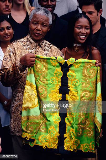 Fashion models gather as Naomi Campbell presents Nelson Mandela with a green Versace shirt. Former President of South Africa and longtime political...