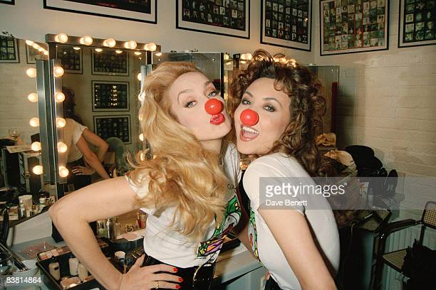 Fashion models Jerry Hall and Marie Helvin pose in their red noses for Comic Relief 10th March 1995