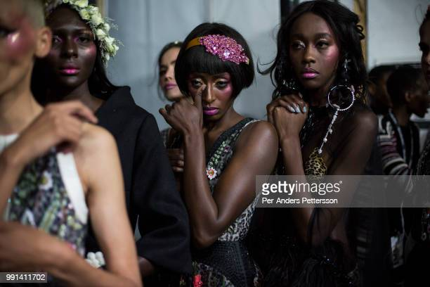 Fashion models line up before a show on August 17 2017 in Mall of Africa north of Johannesburg South Africa Local and African designers showed their...